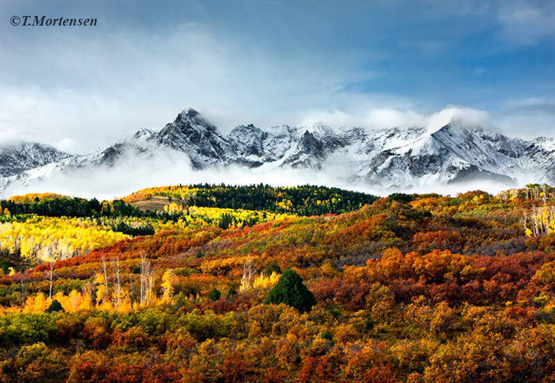 Majestic San Juan Mountains after the first snow of the season surrounded by fall colors at their peak.