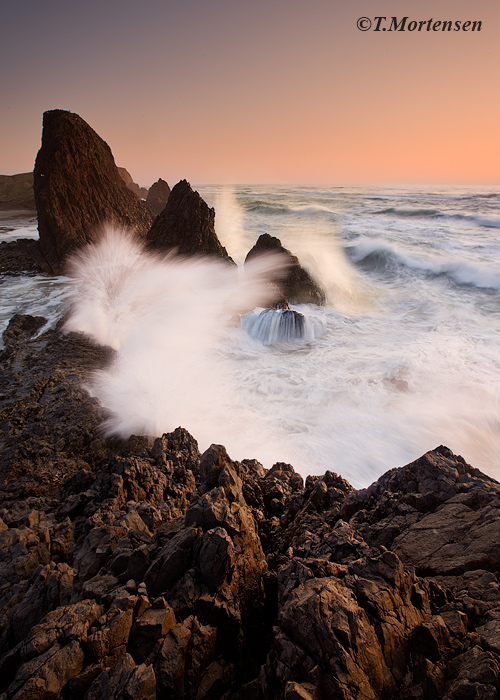 Big waves exploded as they crash into the rugged coast of Oregon