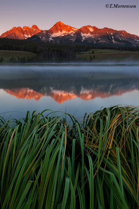 A remote pond at the base of the Sawtooth Mountains made for a peaceful location during an early sunrise.