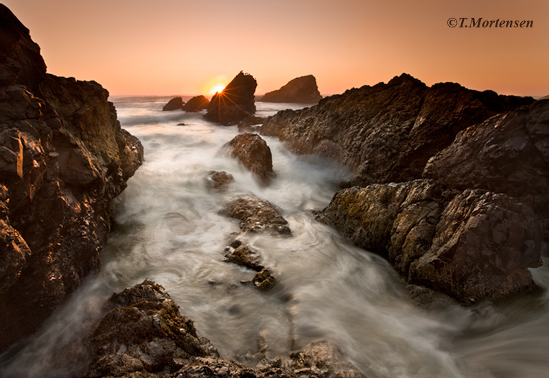 Hidden rocks along the Oregon coast open up to this secluded cove.